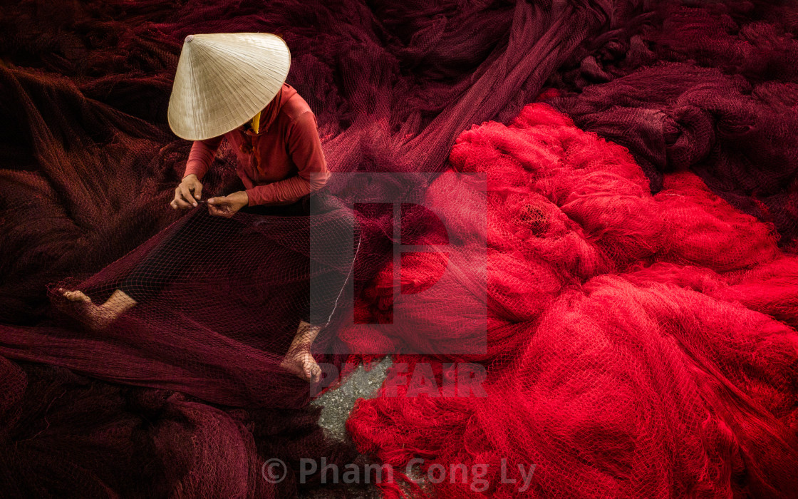 """Sewing the fishing net"" stock image"