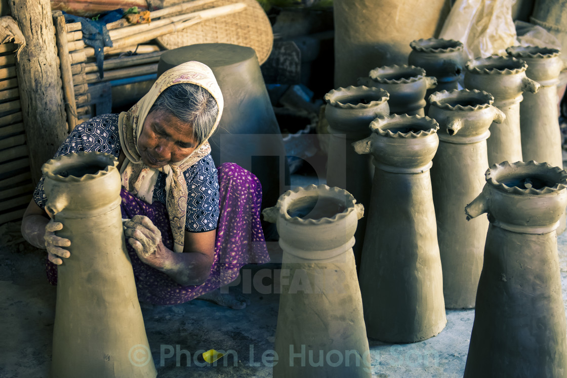 """Old Artist making the mug with clay."" stock image"