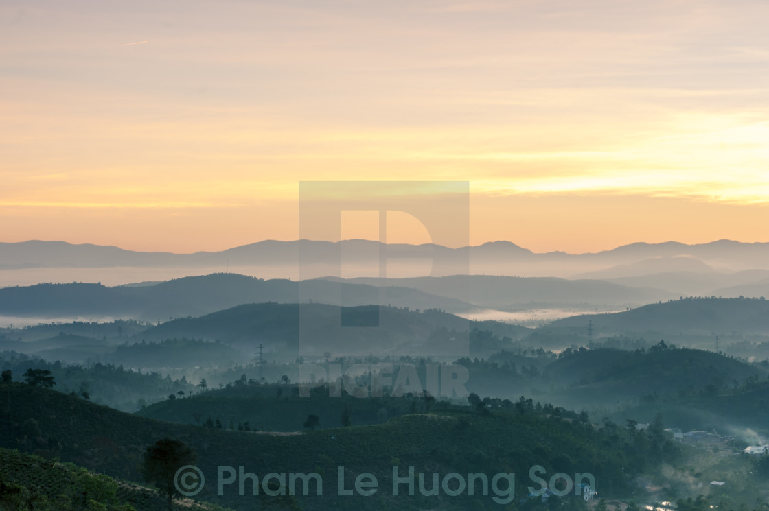 """Dramatic sunrise sky on the valley"" stock image"