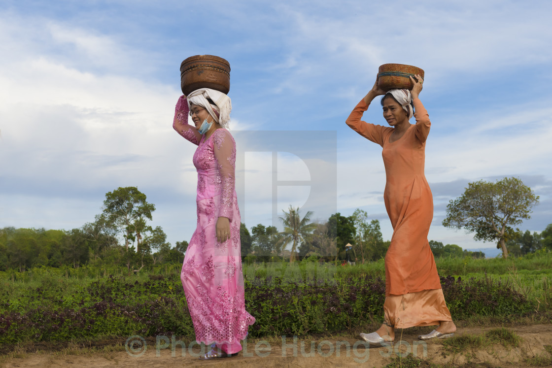 """""""Beautiful Cham ladies in their traditional clothes."""" stock image"""