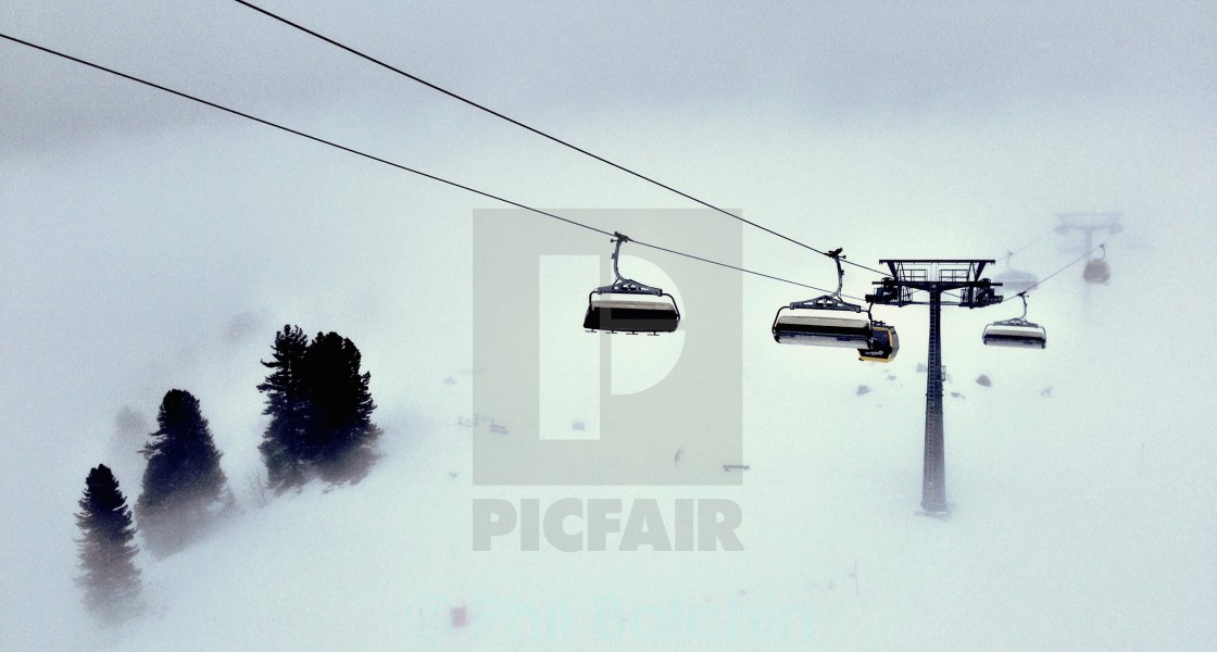 """Ski lifts in the mist"" stock image"