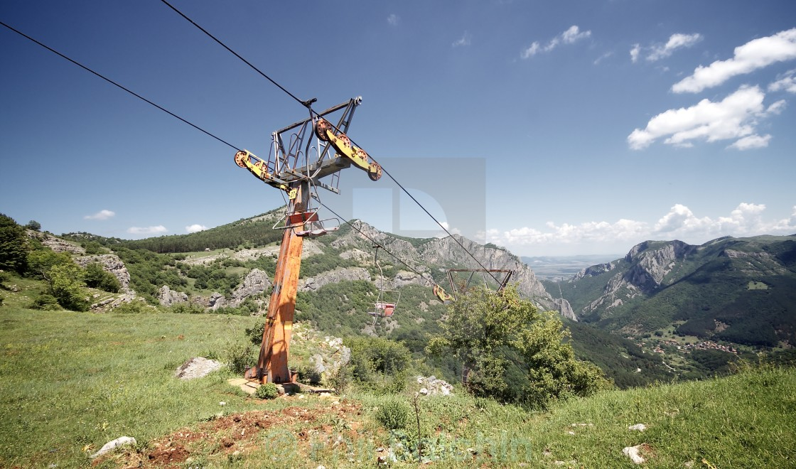 """Abandoned Chair Lift"" stock image"