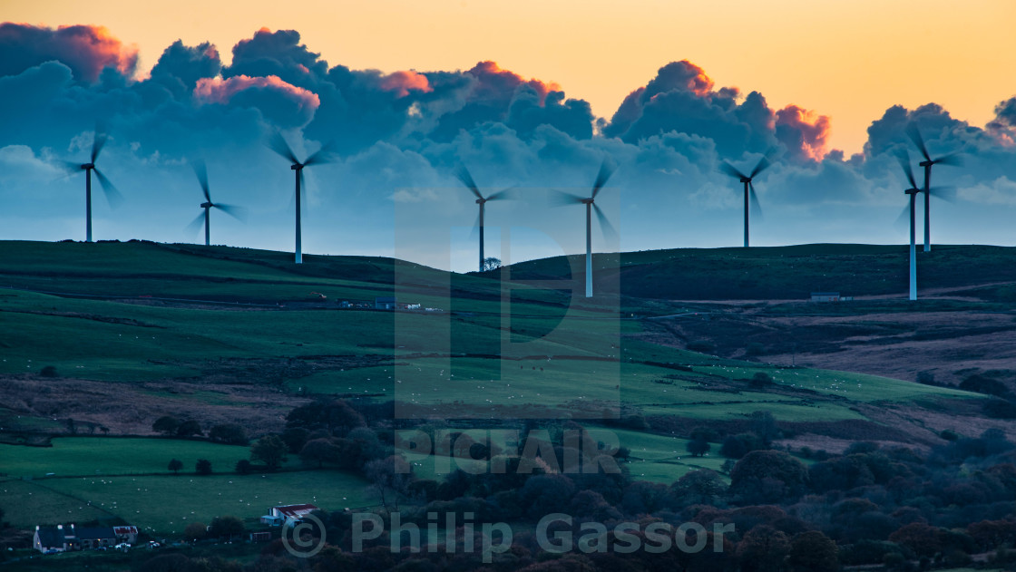 """Wind turbines and Sheep on a Welsh hill farm."" stock image"