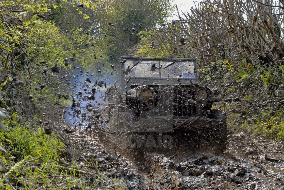 """world war two military vehicle run in mud"" stock image"