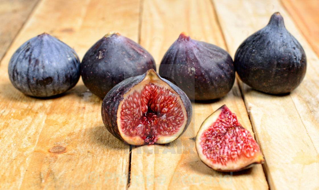 """""""figs placed on a wooden table"""" stock image"""