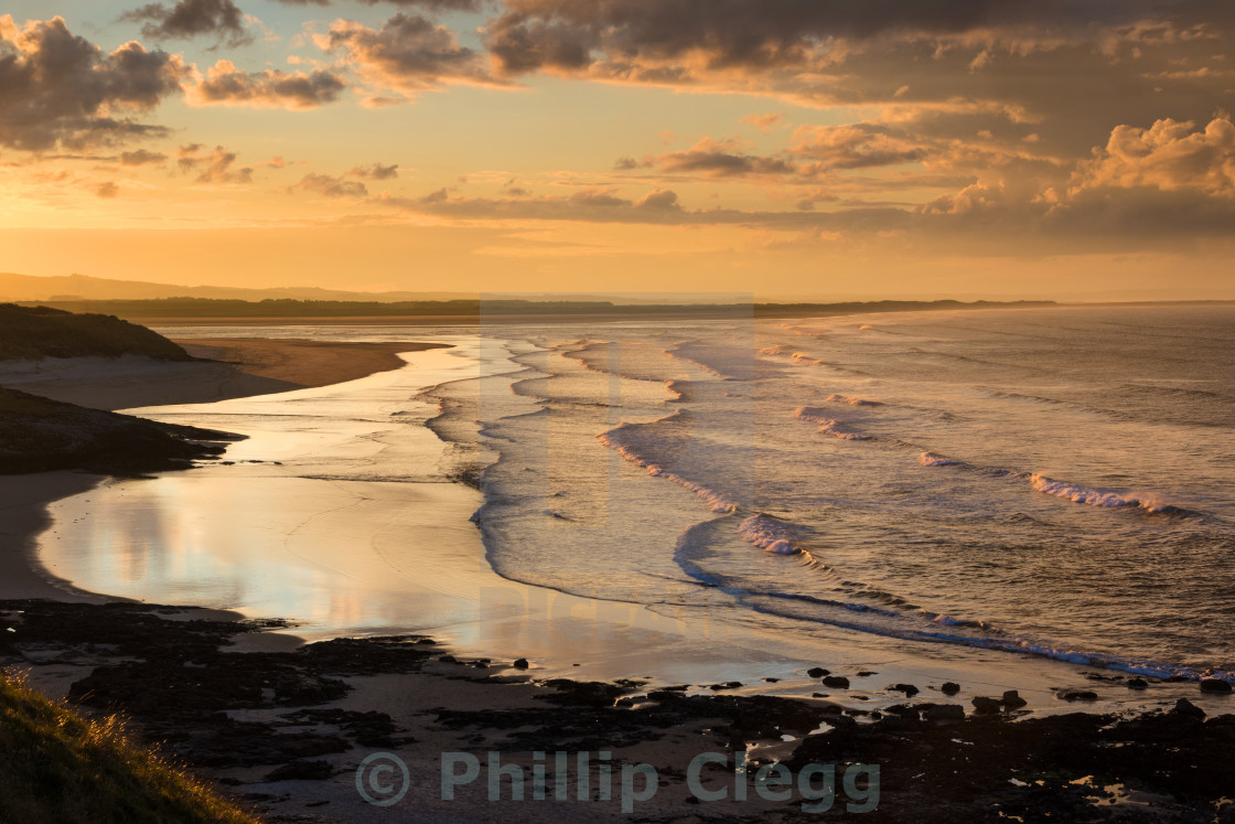 """Sunset over Budle Bay"" stock image"