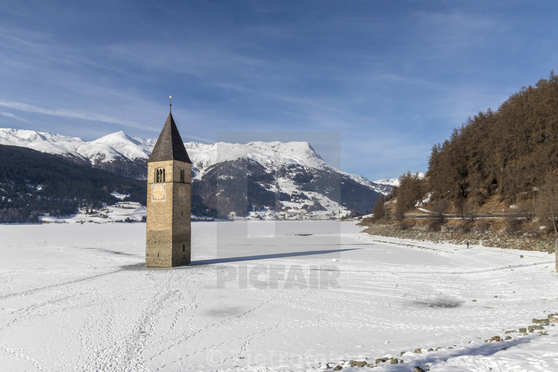 Snow on the submerged bell tower of resia