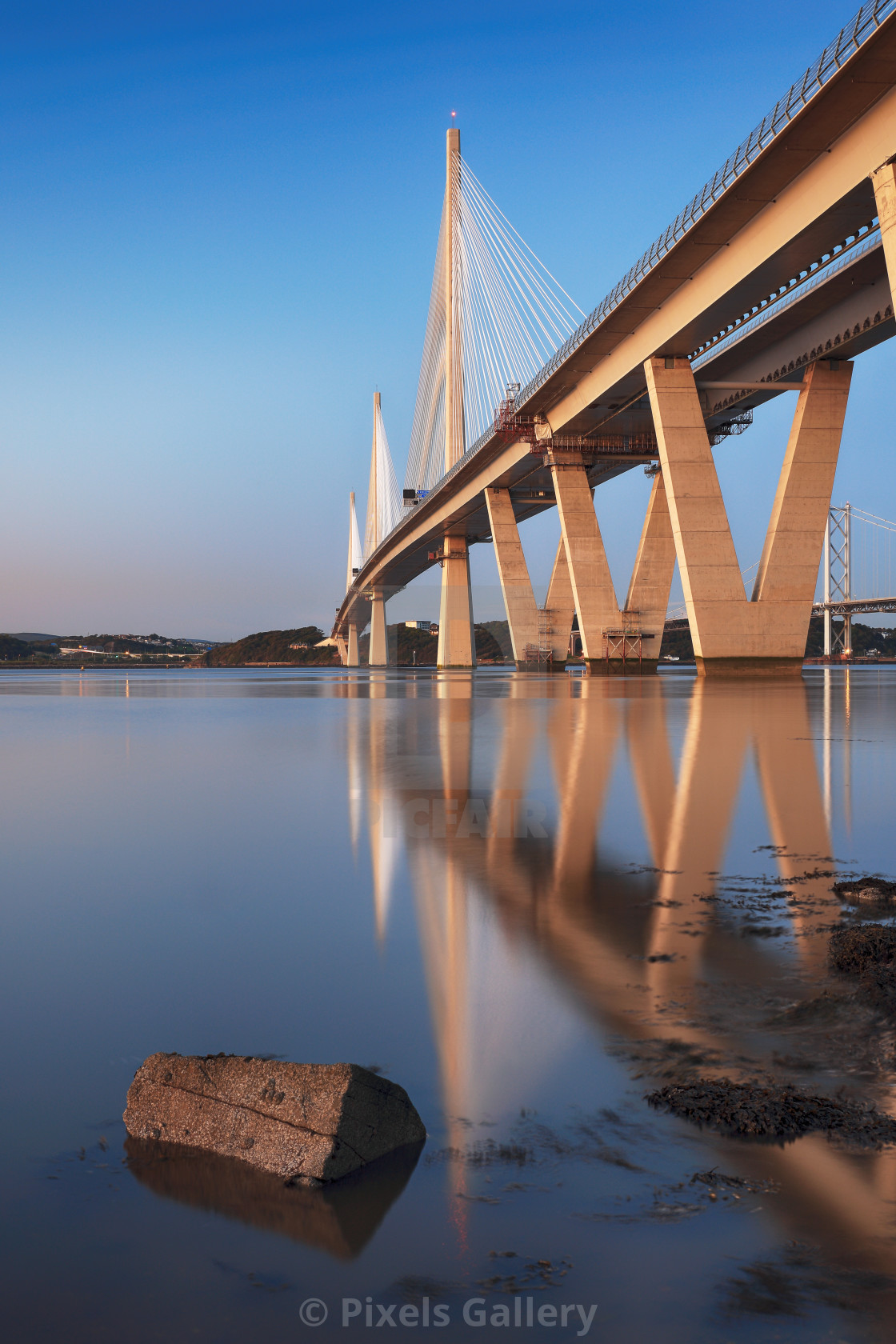 """The new Queensferry crossing bridge reflecting on the Firth of Forth, South Queensferry, Edinburgh."" stock image"