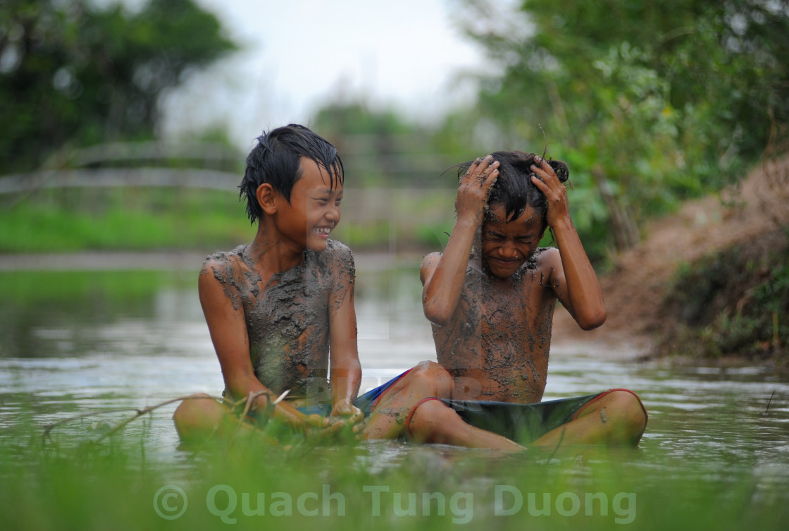 """KIDS MUD BATH"" stock image"
