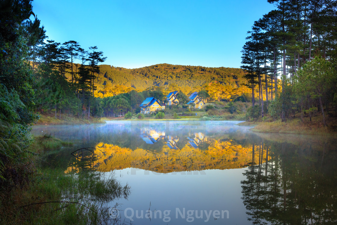 """villas reflect on lake, eco holiday resort among green pine forest"" stock image"