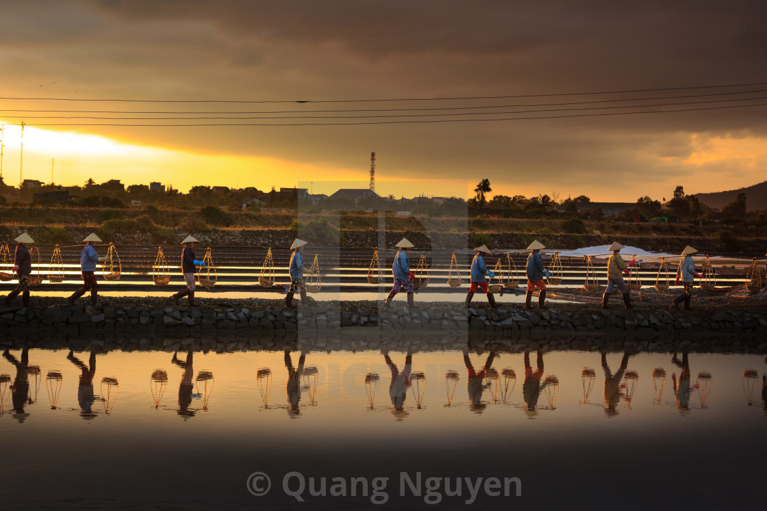 """the women are working on salt field at dawn"" stock image"