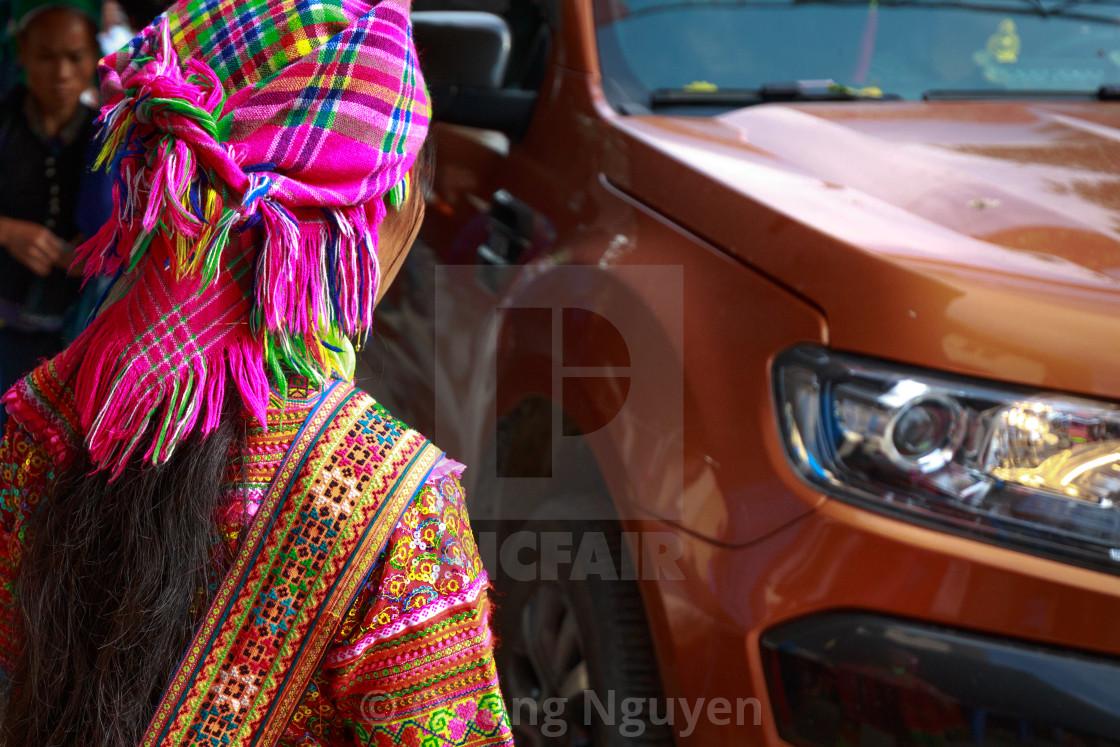 """woman ethnic minorities and Ford Ranger pickup vehicle"" stock image"