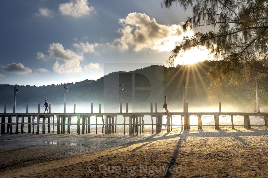 """Dawn on Pier on the beach of Koh Rong Samloem island in Cambodia"" stock image"