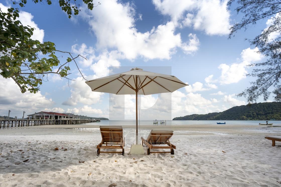 """The sun loungers under umbrellas on the sandy beach on paradise island Villa Koh Rong Samloem. Cambodia."" stock image"