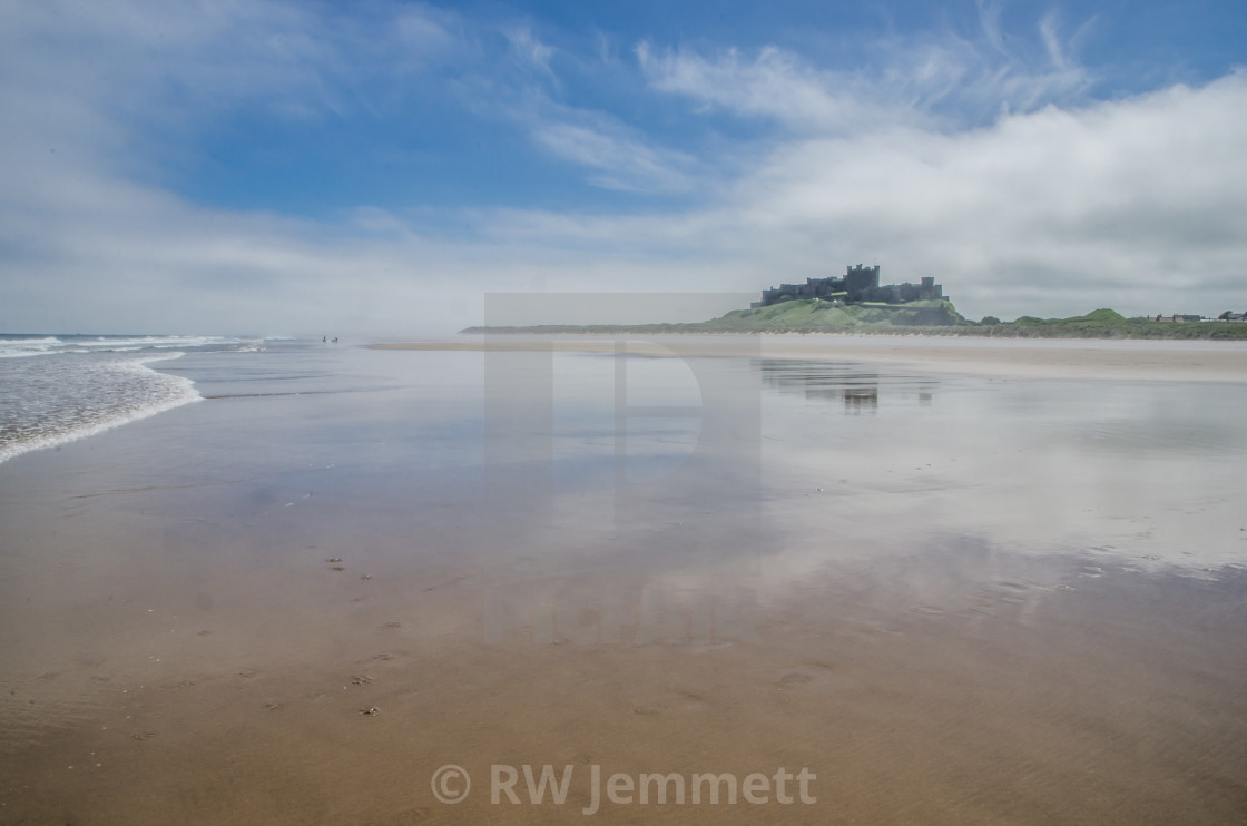 """Bamburgh castle and beach"" stock image"