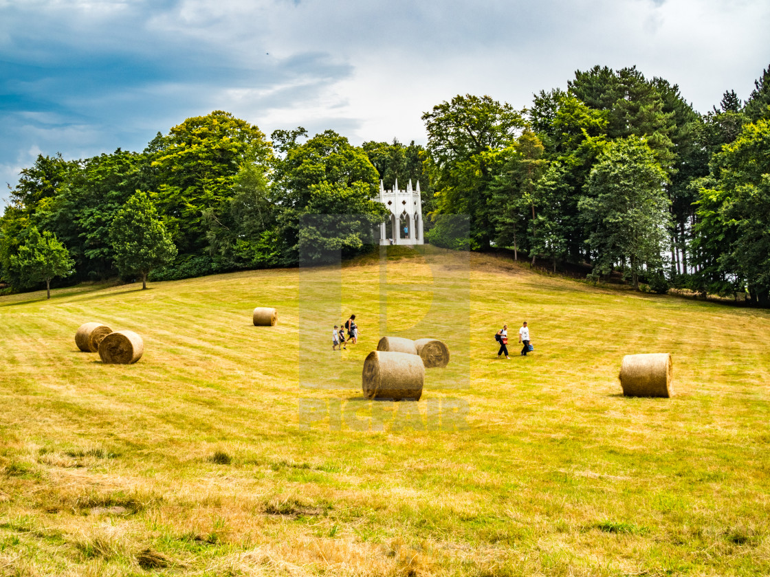 """Painshill Park, Cobham Surrey, England. 4 August 2019. Family running through..."" stock image"