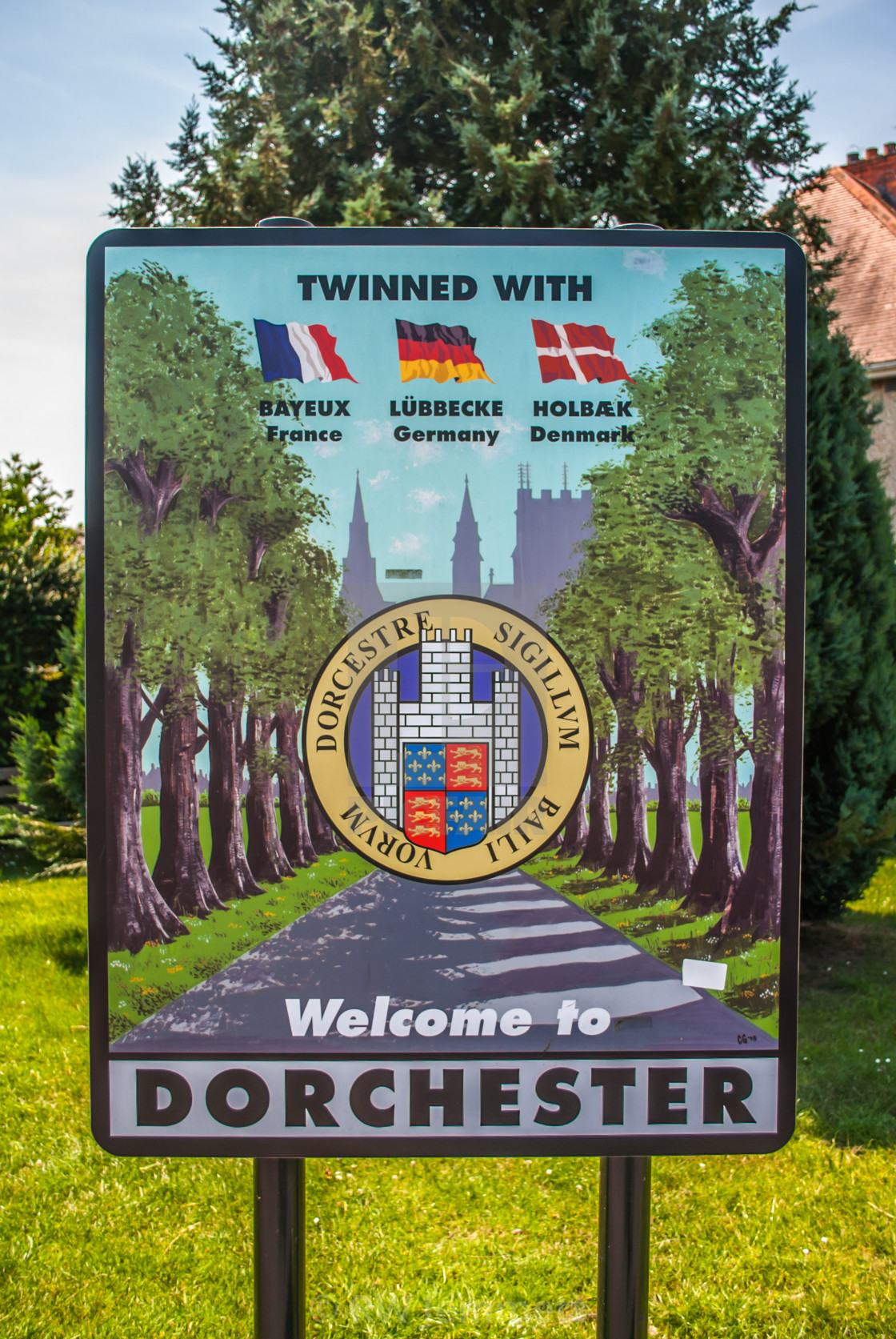 """Welcome to Dorset Town Sign showing twinned cities Bayeux, Lubbecke and Holbaek"" stock image"