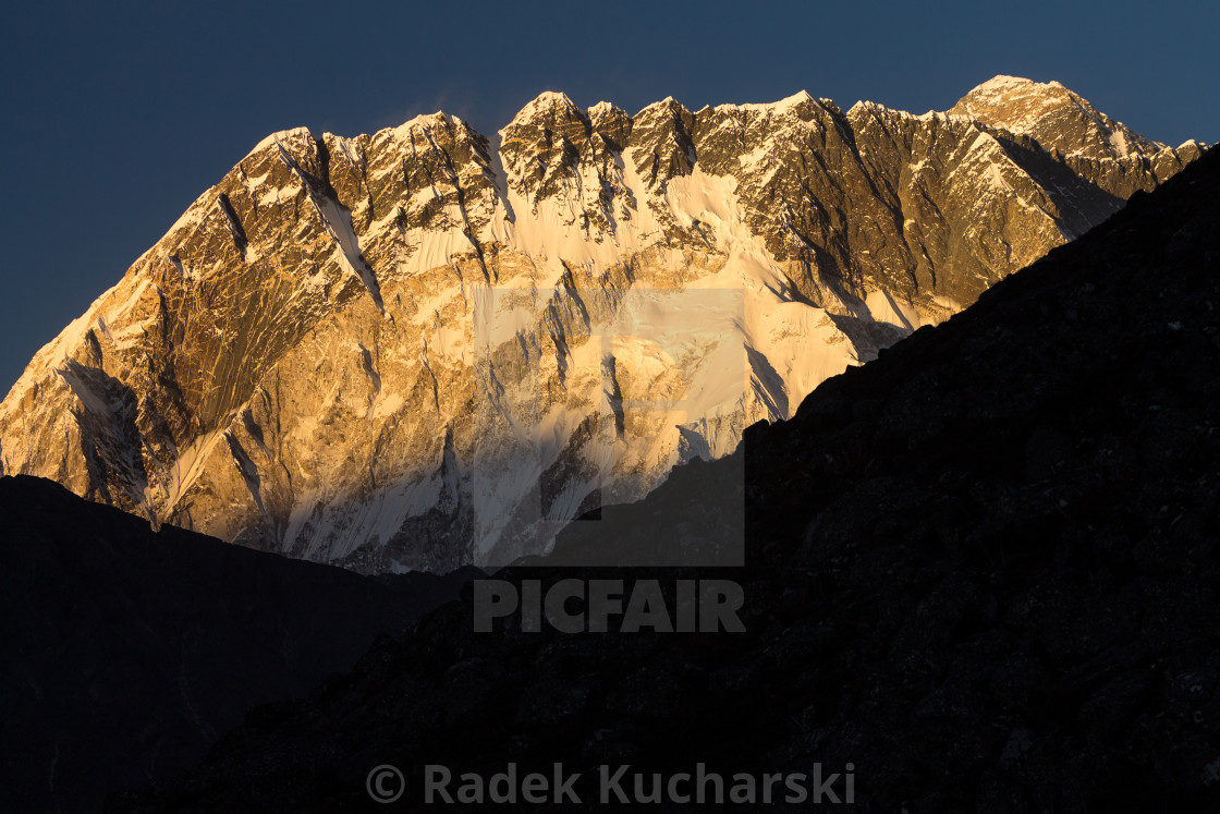 """Nuptse shortly before sunset with Everest rising above its long ridge"" stock image"