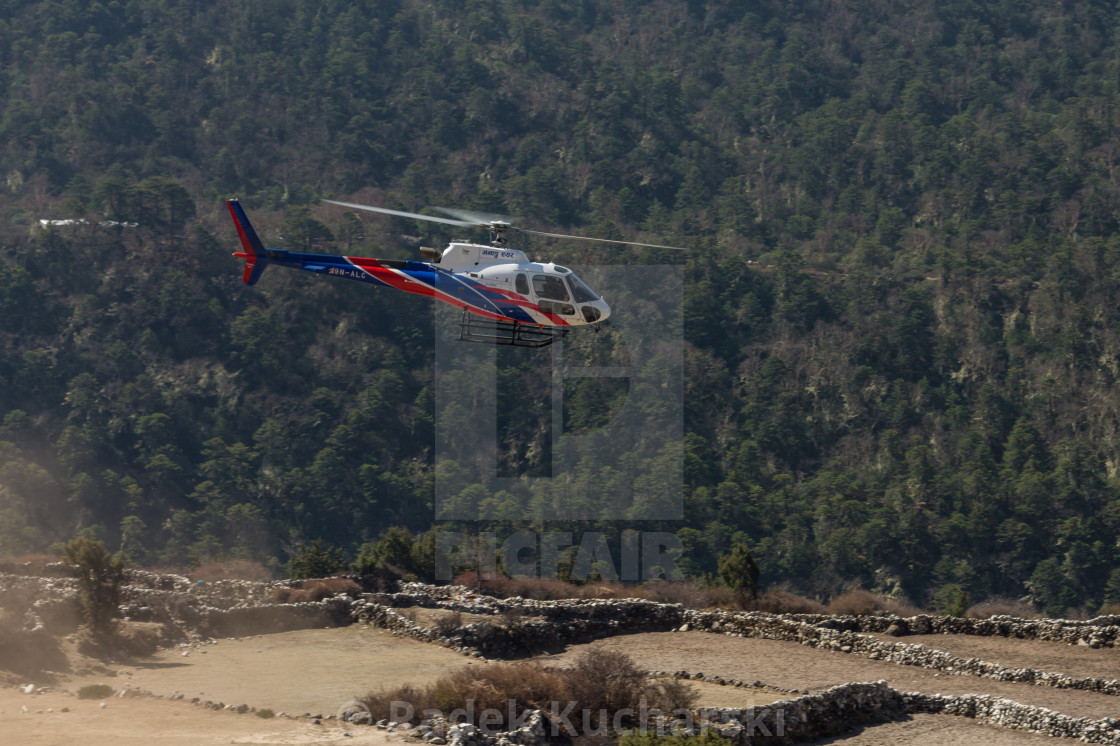 """Helicopter just after take off at Pangboche village"" stock image"