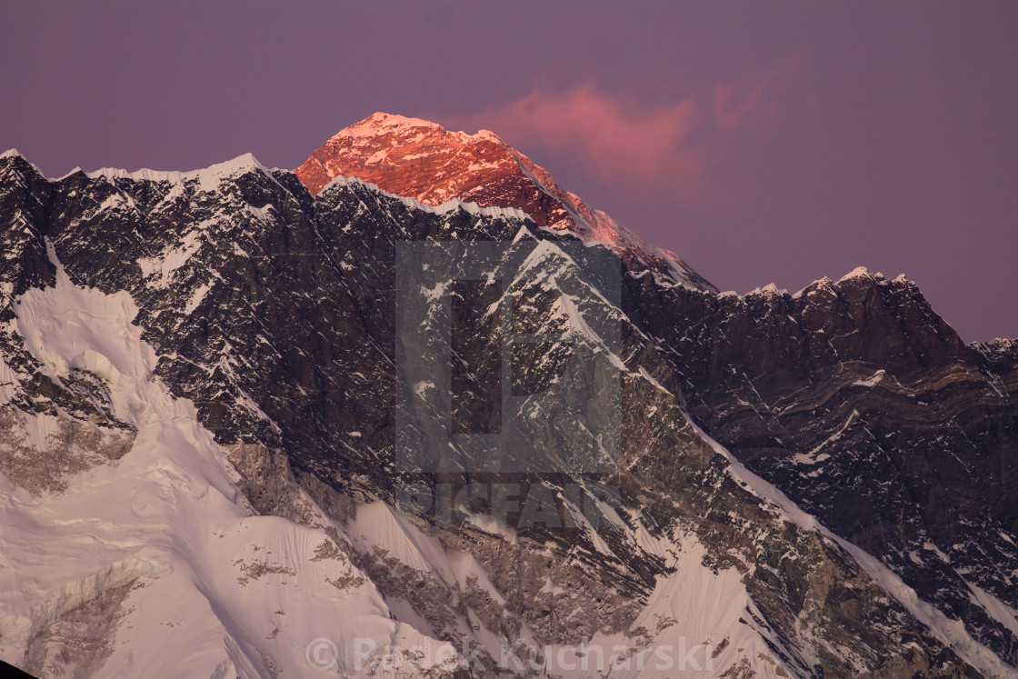 """Mt. Everest rising above the Nuptse-Lhotse Ridge at dusk"" stock image"