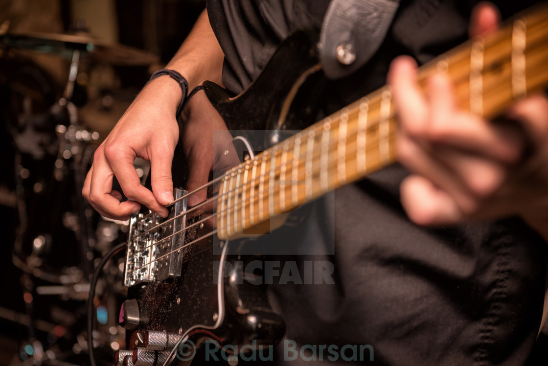 """Playing the bass"" stock image"