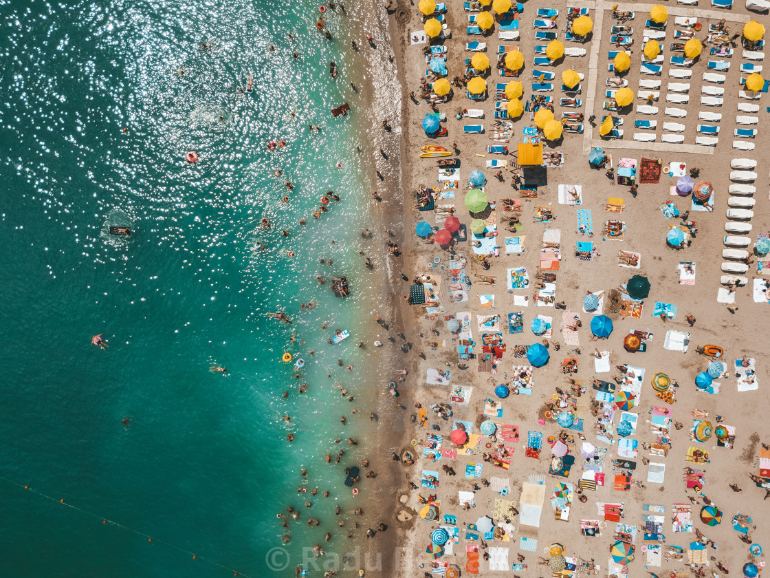 """Aerial View From Flying Drone Of People Crowd Relaxing On Beach In Romania At The Black Sea"" stock image"