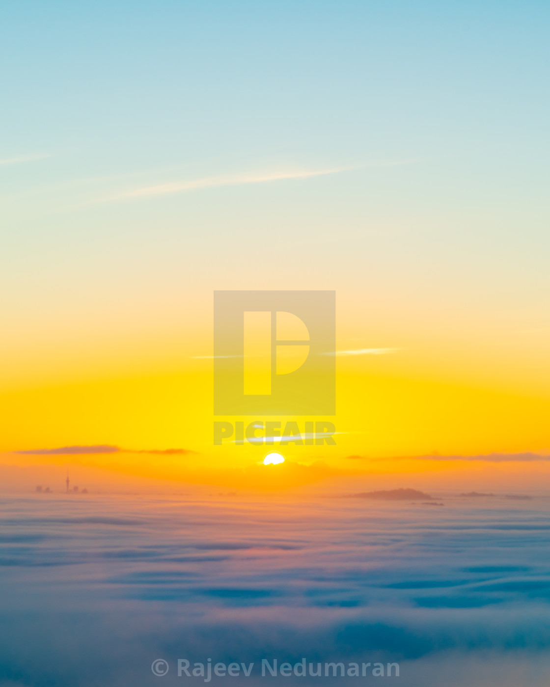 """Sunrise in the clouds"" stock image"