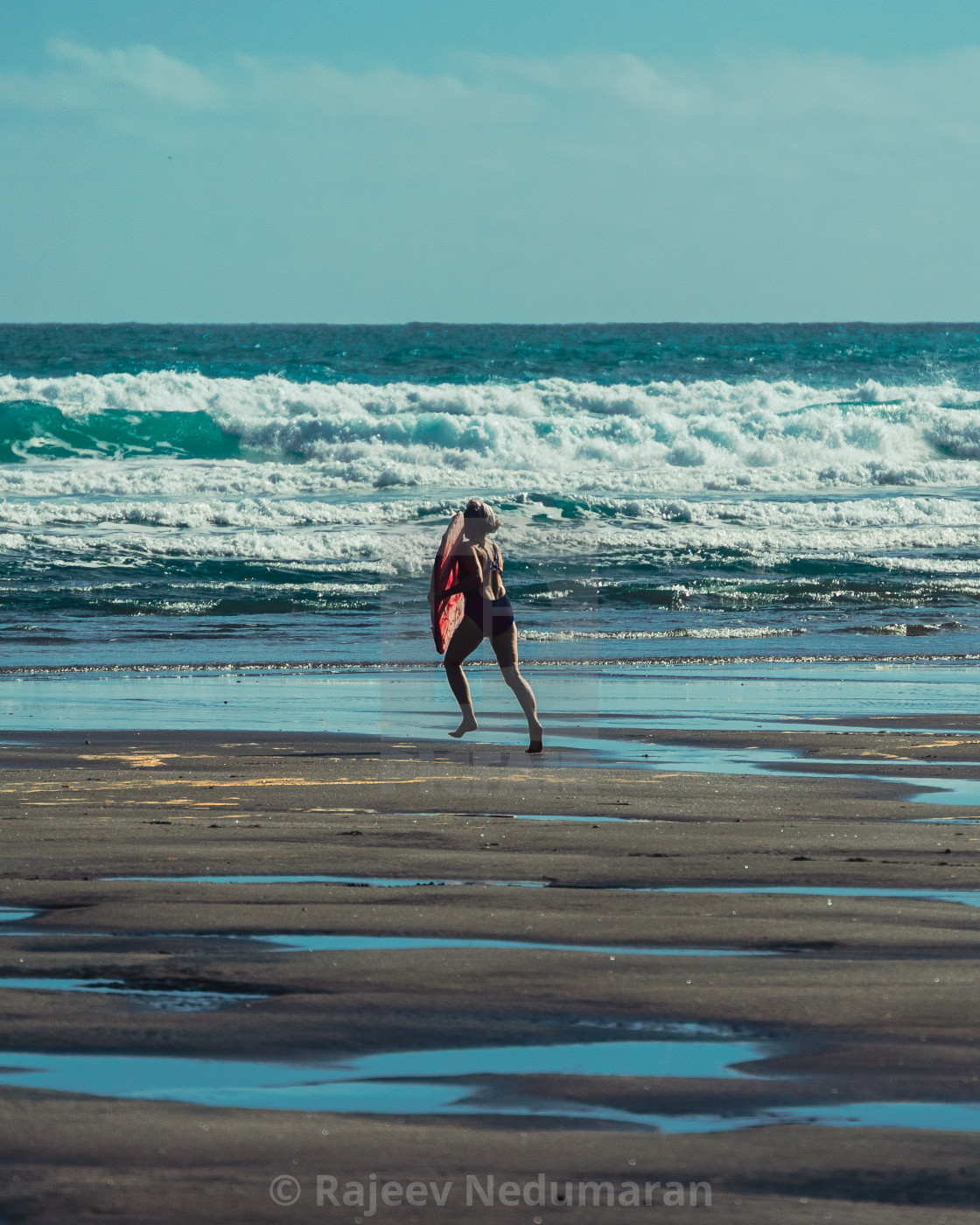 """Surfer on the beach"" stock image"