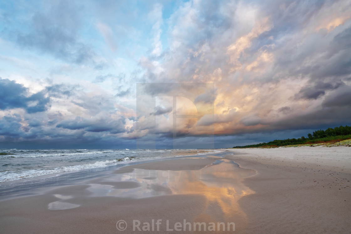 """""""Beach view with coloured clouds and reflection"""" stock image"""