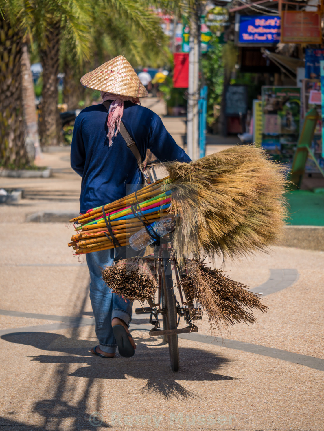 """Unknown Street vendor of traditional made brooms.Street vending is very..."" stock image"