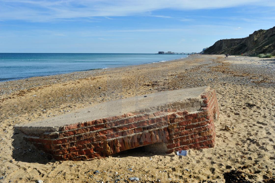 """A WW2 Pillbox lies on the beach near Cromer, Norfolk"" stock image"