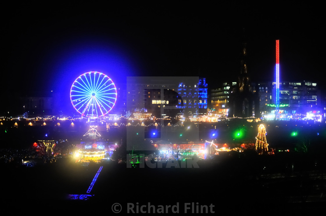 """Edinburgh Christmas Market lit up at night"" stock image"