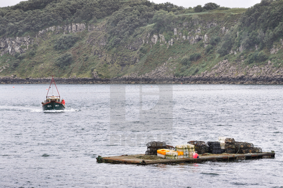 """""""Picking up the pots - Portree Harbour, Isle of Skye"""" stock image"""