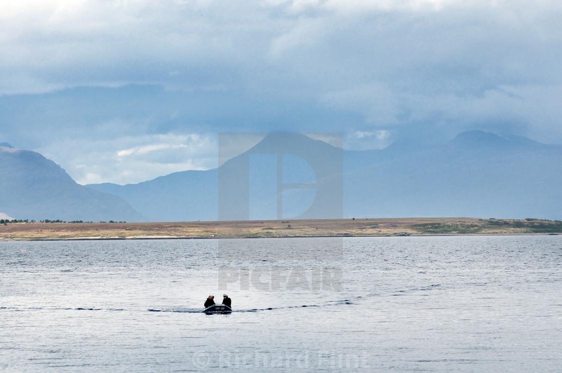 """Dinghy heading to shore - Broadford, Isle of Skye"" stock image"