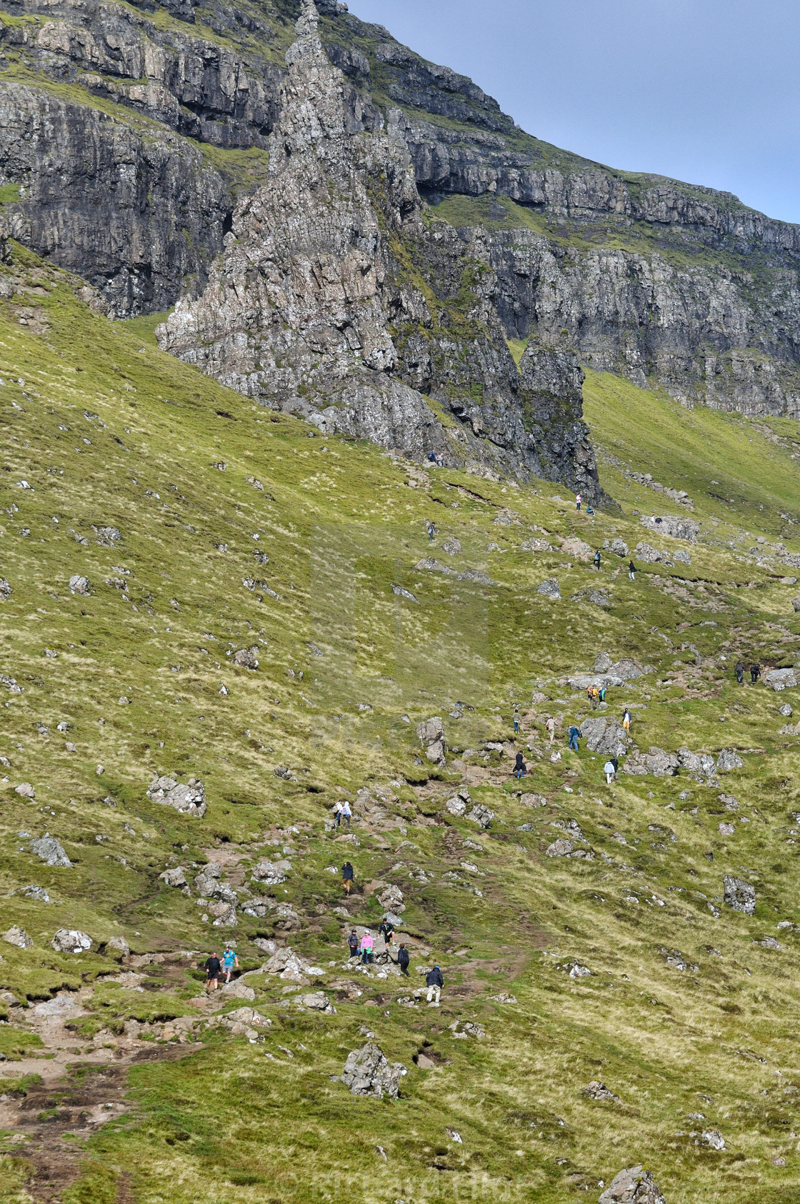 """People climbing the path to the Old Man of Strorr, Isle of Skye"" stock image"
