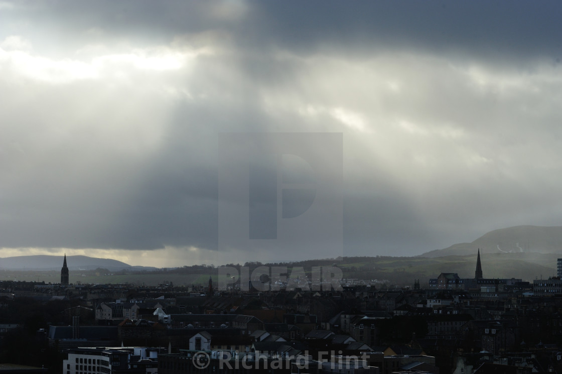 """Rain heads in over Edinburgh, Scotland"" stock image"