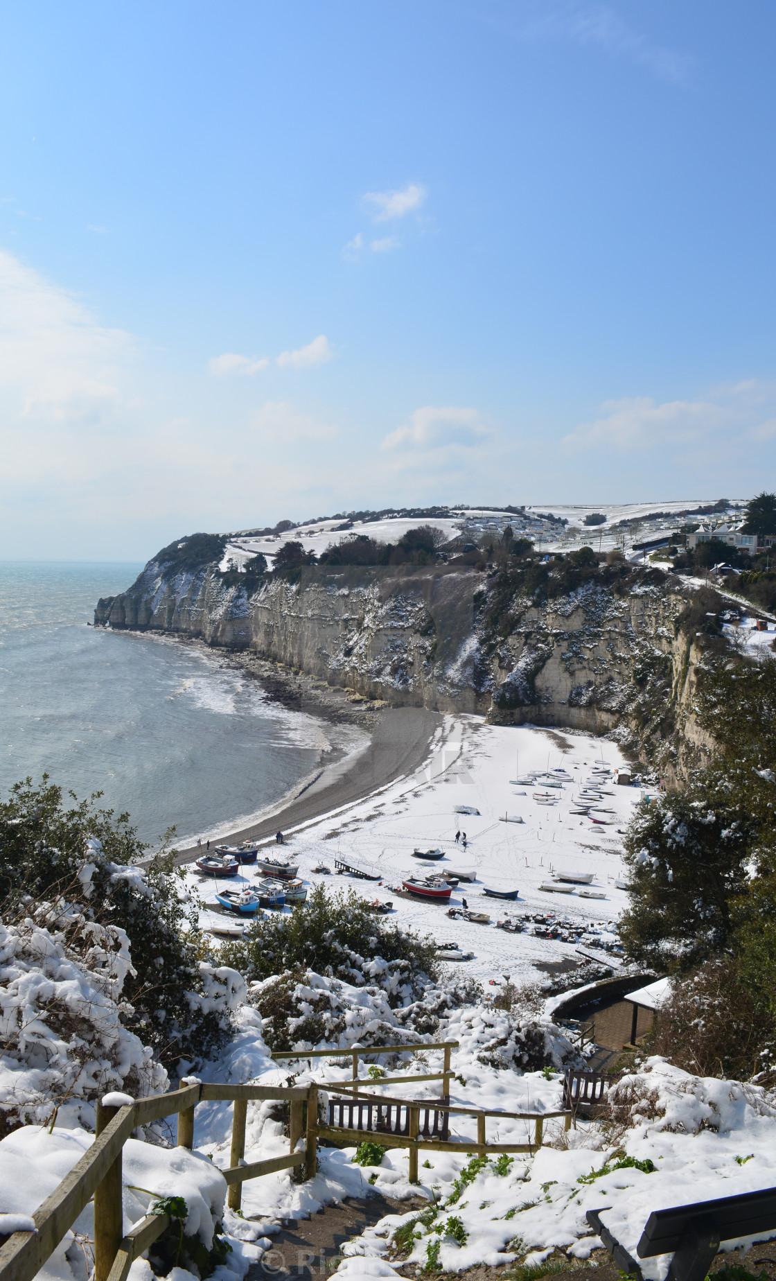 """Snow on the beach, Beer, Devon, England."" stock image"