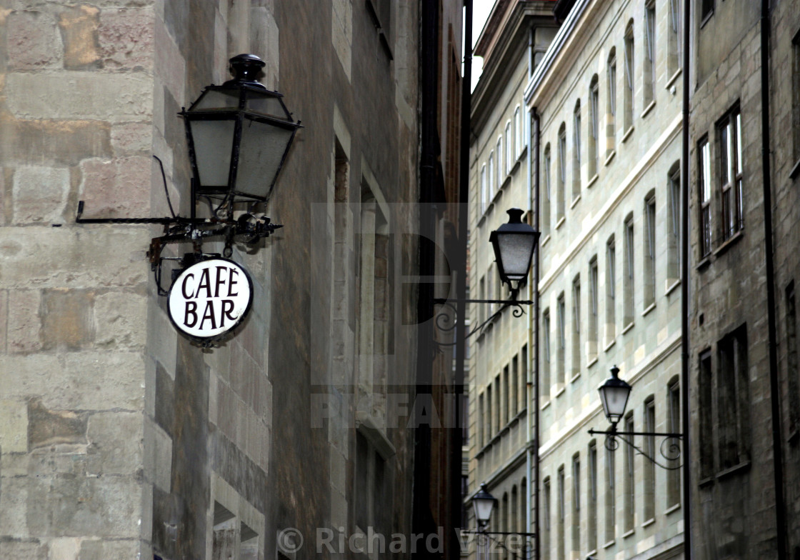"""Cafe sign and street lamps, Geneva"" stock image"