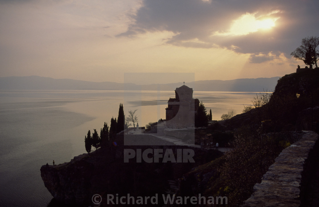 """Ohrid Macedonia Sveti Jovan Bogoslov Kaneo. Church at sunset, sunbeams..."" stock image"