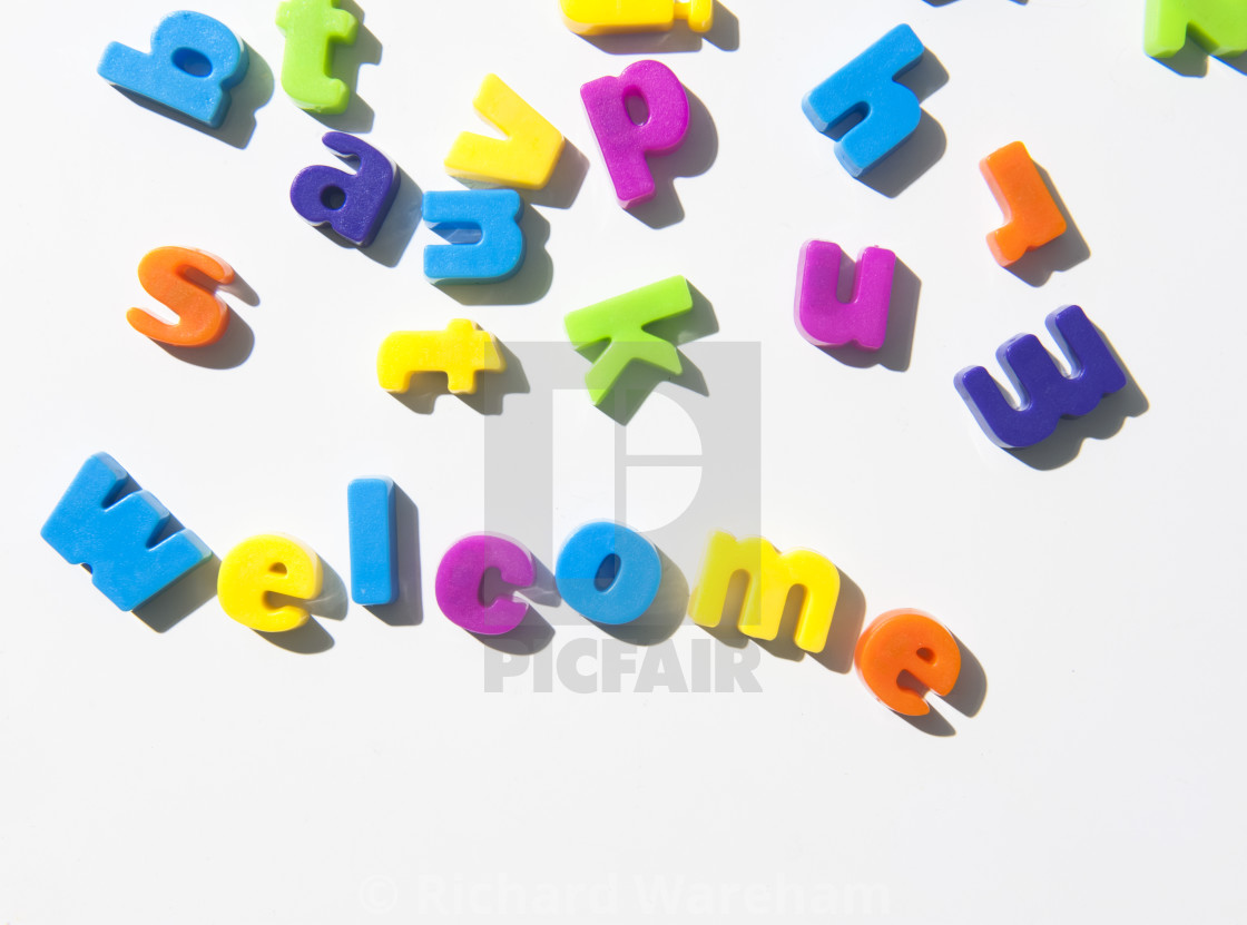 fridge magnet letters spell welcome stock image