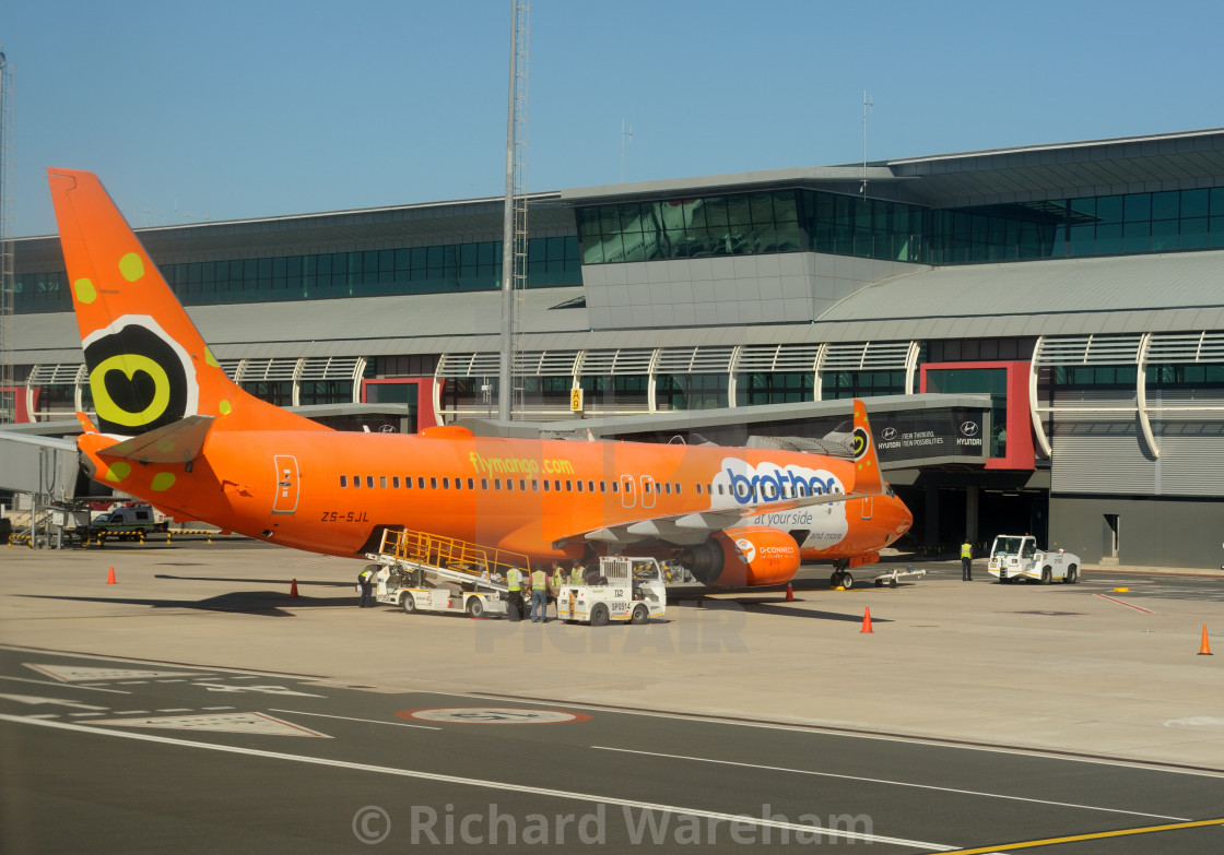 """""""Durban South Africa King Shaka Airport Mango Airlines Boeing 737 with Brother..."""" stock image"""