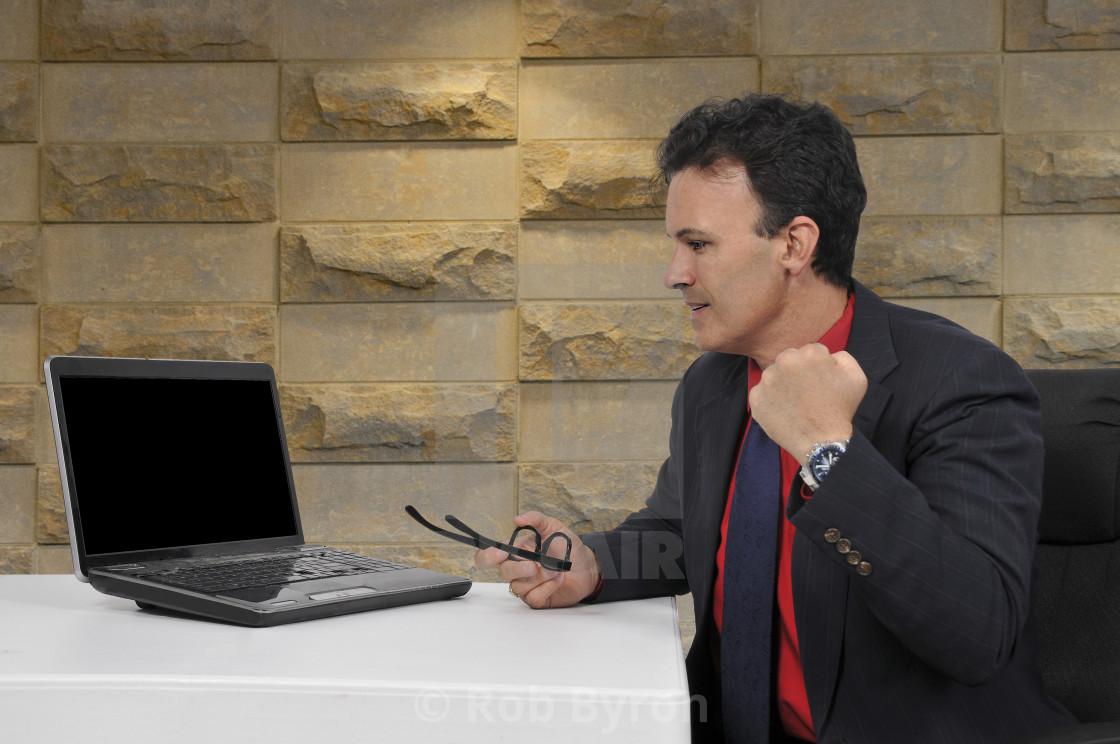 """Salesman at a computer"" stock image"