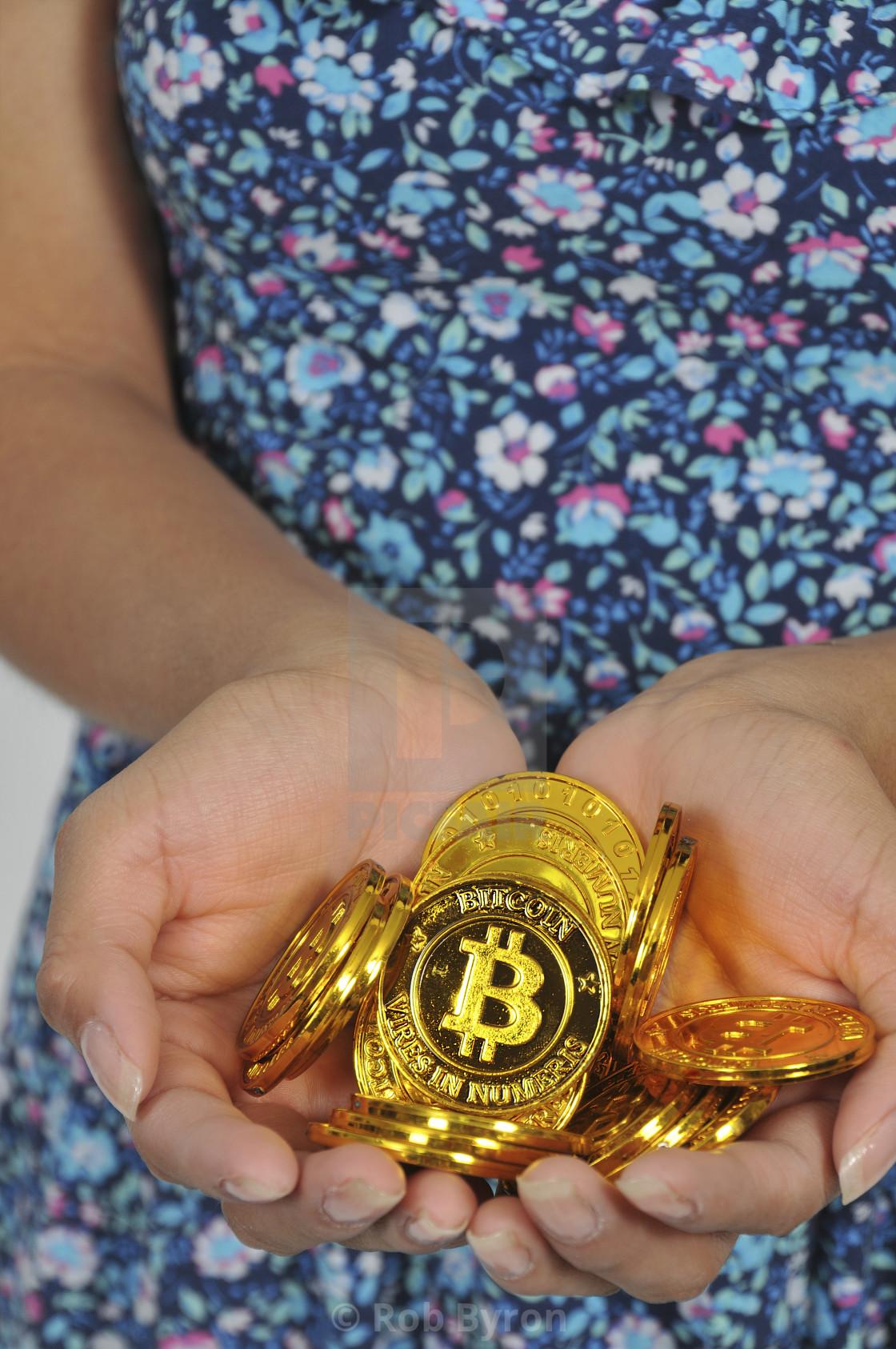 """Woman holding Bitcoin"" stock image"