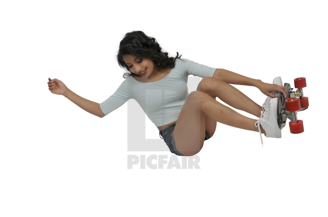 """Woman riding skateboard"" stock image"