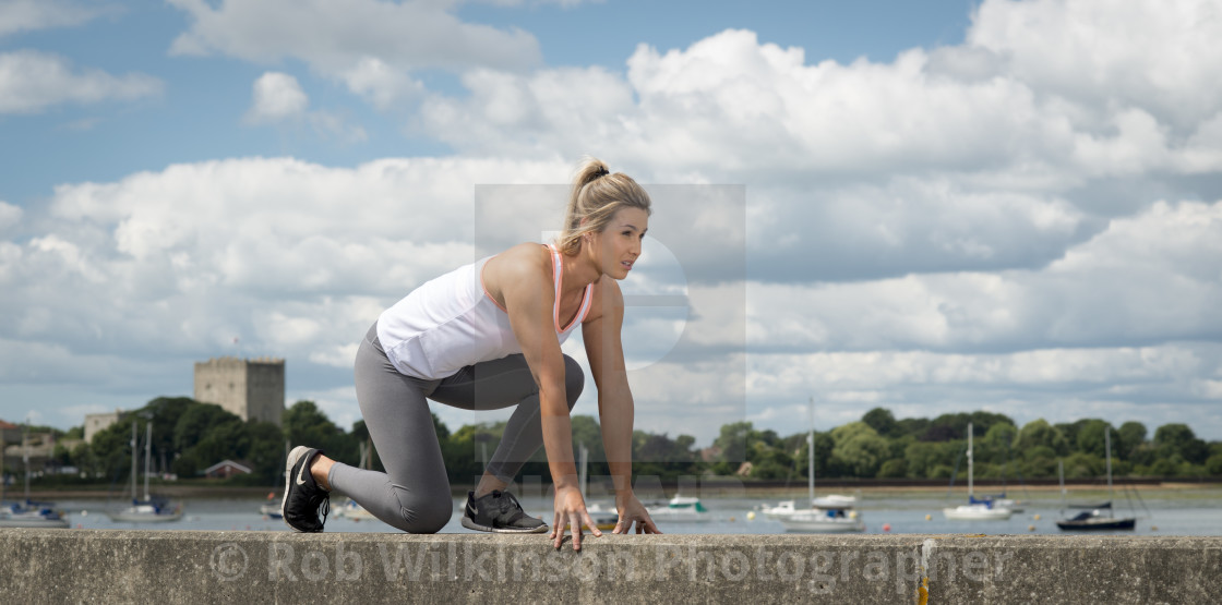 """""""fit woman about to run, workout"""" stock image"""