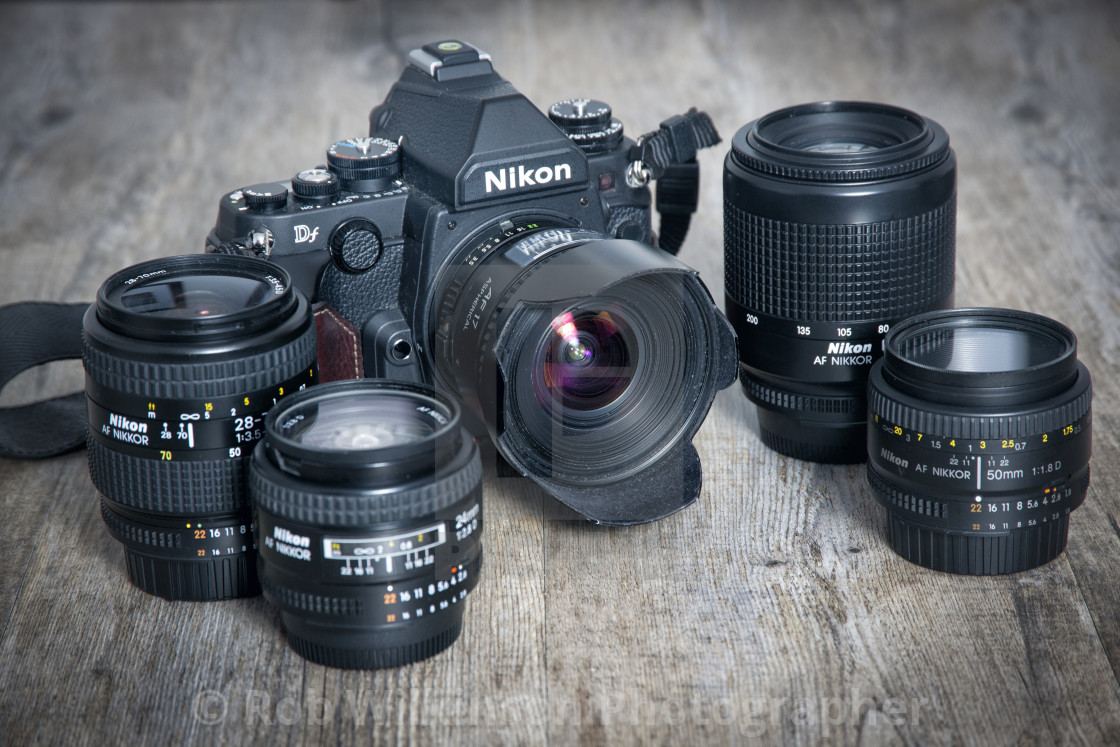 """Nikon Df dslr camera and a selection of lenses. Retro design."" stock image"
