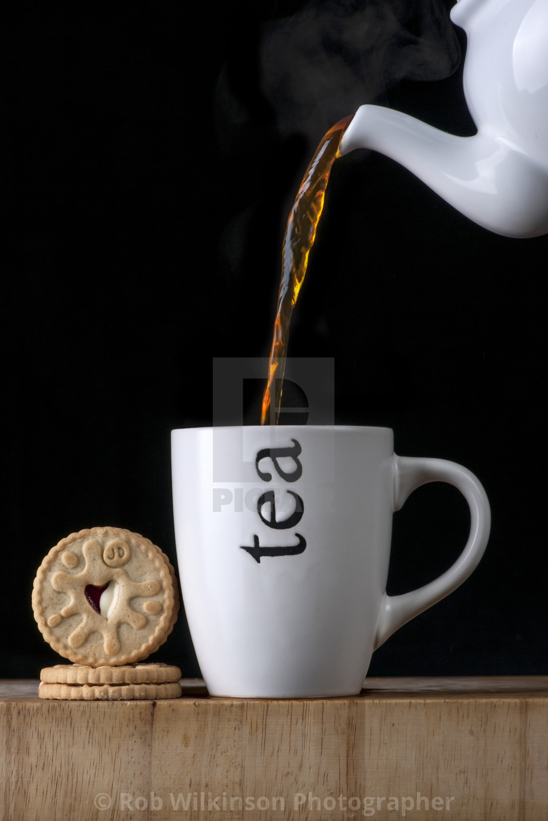 """""""pouring a cup of tea"""" stock image"""