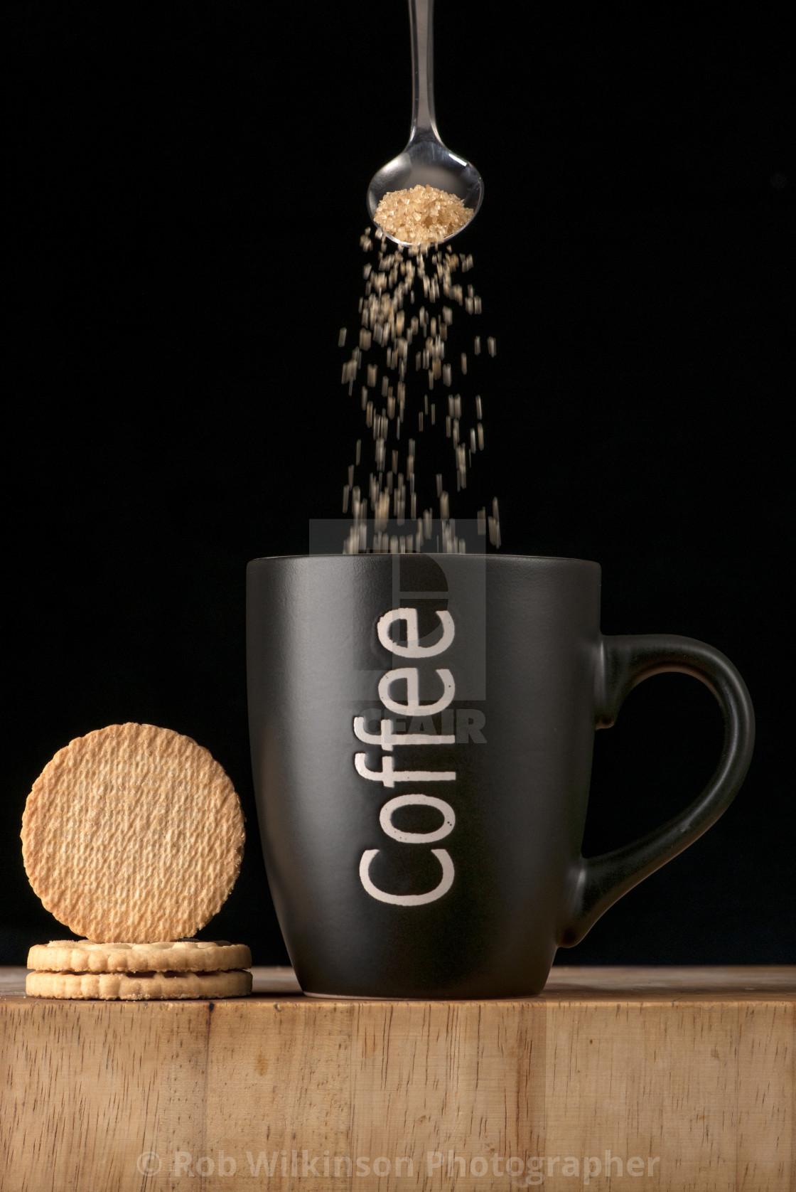 """""""adding sugar to a mug of coffee"""" stock image"""
