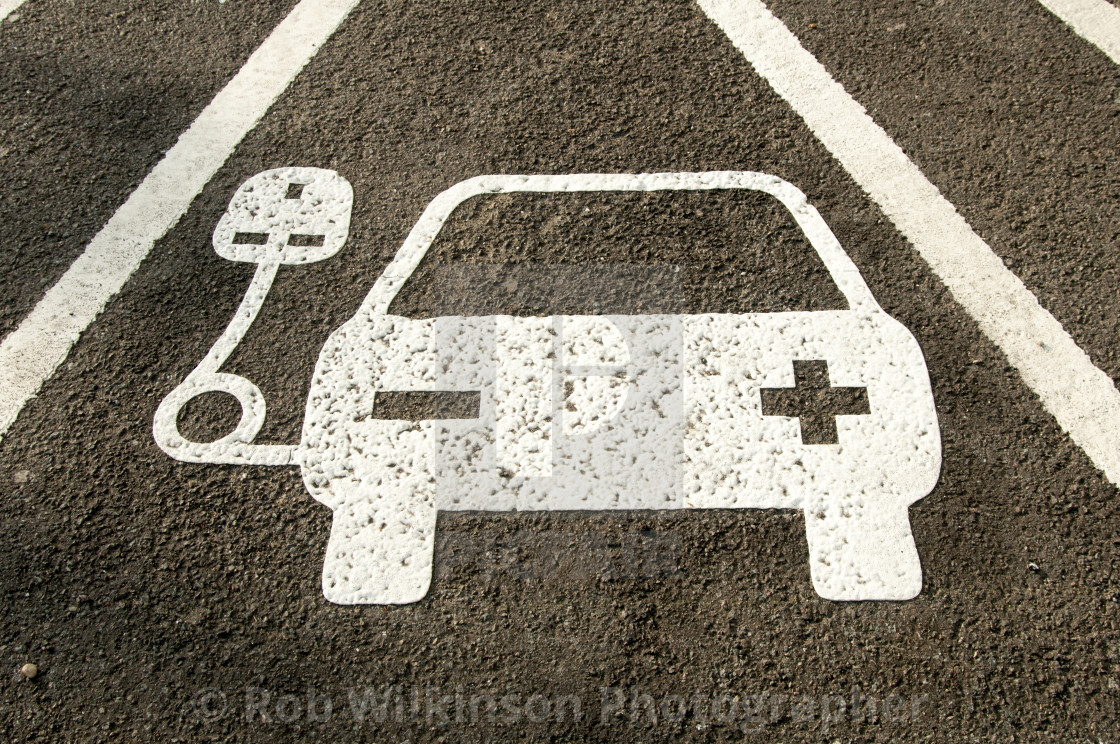 """""""electric vehicle recharging point sign painted on the road"""" stock image"""