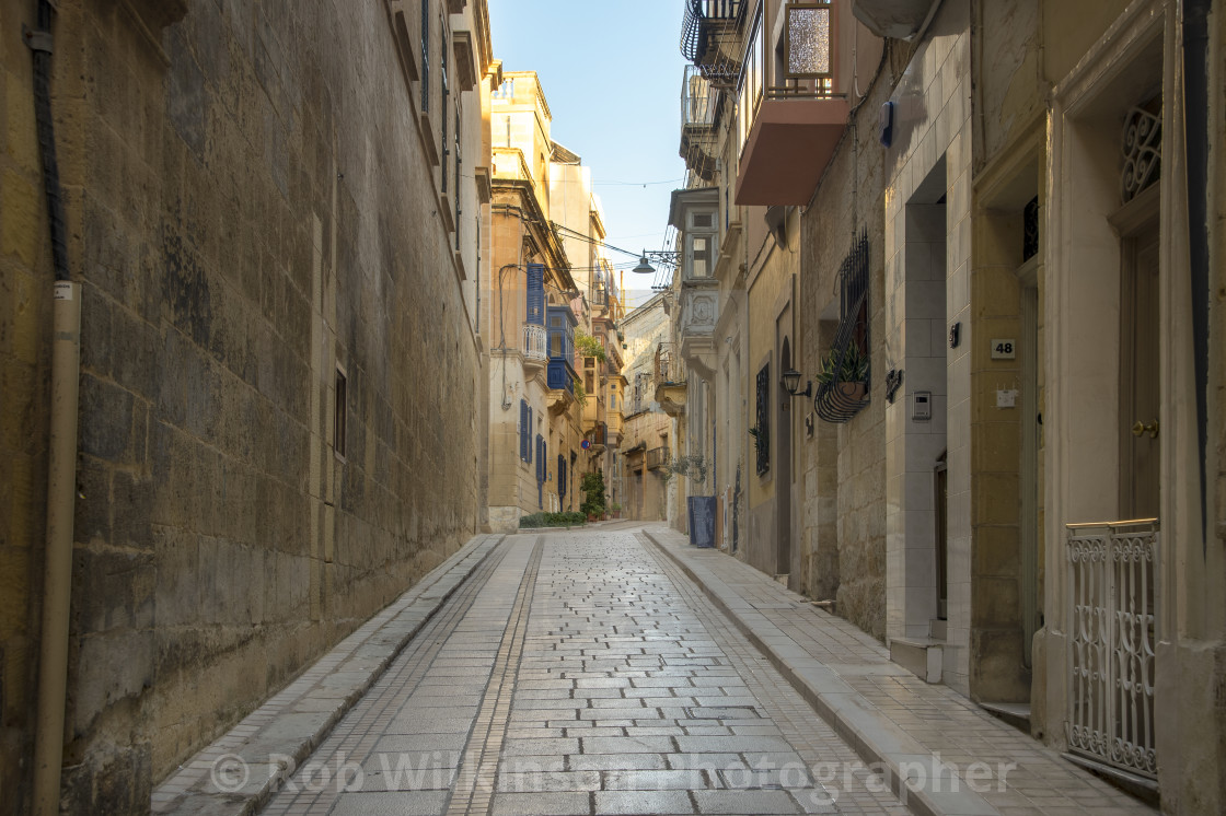 """narrow streets of Vittoriosa, Malta. Traditional limestone buildings and covered balconies."" stock image"